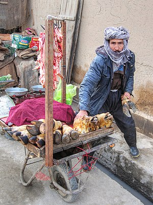 Hawker (trade) - A hawker selling goat meat in Kabul