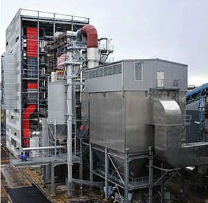 Biomass - A cogeneration plant in Metz, France. The station uses waste wood biomass as an energy source, and provides electricity and heat for 30,000 dwellings.