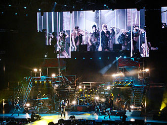 """Can't Be Tamed (song) - Cyrus performed """"Can't Be Tamed"""" on the Gypsy Heart Tour, with the music video displayed on the screen."""