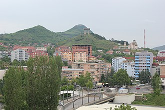 North Mitrovica - View of North Mitrovica , Zvečan Fortress on the mountain to the left, and Trepča chimney on the right.