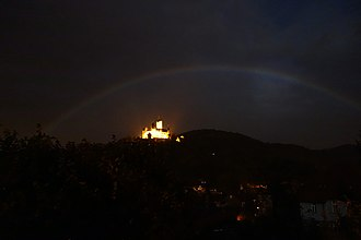 Moonbow - Photograph of a real moonbow spanning over castle of Wernigerode, Germany