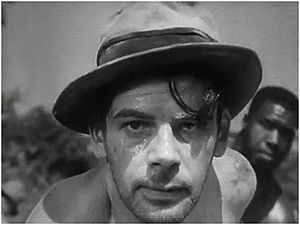 Pre-Code crime films - Paul Muni prepares to have his ankle shackles bent, via sledge hammer, by the prisoner, in the background in I Am a Fugitive from a Chain Gang (1932). Based on the autobiographical memoirs of Robert E. Burns, who was himself a fugitive at the time of the picture's release, the film was a powerful agent for social change.