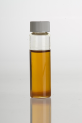 Glass vial containing oil