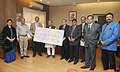 Narendra Singh Tomar receiving the dividend cheque from the CMD of MECON, Shri A.K. Tyagi, in New Delhi on November 13, 2014. The Secretary, Ministry of Steel, Shri Rakesh Singh is also seen.jpg