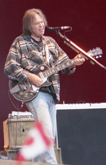 Young performing in 1996 in Turku, Finland Neil Young 1996.jpg