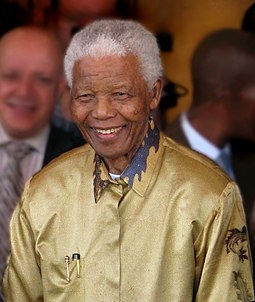 Having successfully campaigned for South Africa to be granted host status of the 2010 World Cup, an emotional Nelson Mandela raised the FIFA World Cup Trophy. Nelson Mandela-2008 (edit).jpg