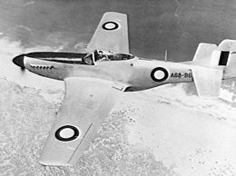 Overhead shot of single-engined fighter aircraft in flight