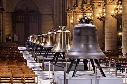 The nine bells of Notre-Dame de Paris Cathedral on public display in the nave in February 2013 (From left to right) Jean-Marie, Maurice, Benoit-Joseph, Etienne, Marcel, Denis, Anne-Genevieve, Gabriel and Bourdon Marie Notre-Dame de Paris - Les nouvelles cloches - 001.jpg