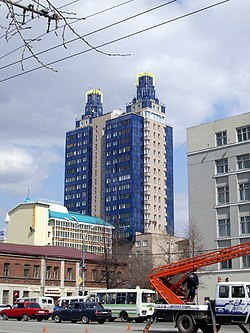 "One of the tallest buildings of Novosibirsk, nicknamed ""BlueTooth"", ""Batman"", ""Plug"", etc."