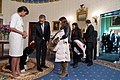 Obamas greet visitors in White House.jpg
