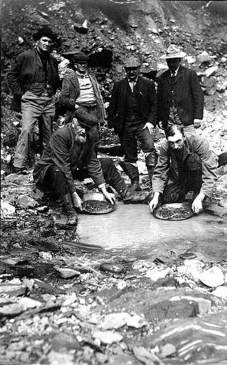 Cooper Landing, Alaska - Panning for gold in Cooper Creek, 1907 photograph by John Nathan Cobb
