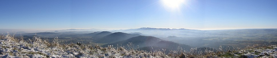 Panorama of the Chaîne des Puys from Puy de Dôme in winter. Massif Central, France. An example of how past volcanic activity shaped a landscape