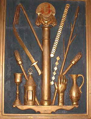 Arma Christi - The instruments of the Passion (cont). Left to right: chalice, torch, lantern, sword, flagellum, pillar of flagellation, Veronica's veil, 30 pieces of silver, dice(?), reed sceptre, hand which struck Christ, torch, pitcher of gall and vinegar.
