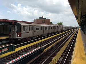 Pelham Bay Park-bound R142A 6 train arriving at Buhre Av.jpg