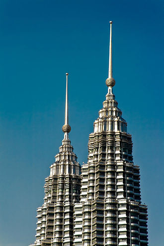Petronas Towers - In accordance with CTBUH, the pinnacles contributed to the overall height of the towers, thus surpassing Willis Tower.