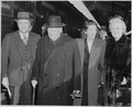 Photograph of former British Prime Minister Winston Churchill shortly after his arrival in the U.S., with members of... - NARA - 199348.tif