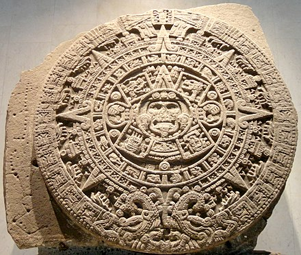 "The ""Aztec calendar stone"" or ""Sun Stone"", a large stone monolith unearthed in 1790 in Mexico City depicting the five eras of Aztec mythical history, with calendric images. Piedra del Sol en MNA.jpg"