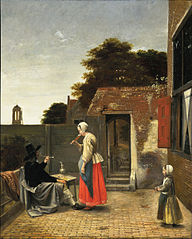 Courtyard with a man smoking and a woman drinking