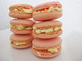 Pink colored macaron parisien with butter cream filling.jpg