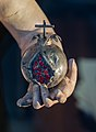 Pomegranate in hand of Jesus, Granada, Spain.jpg