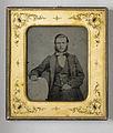 Porträtt, knäbild, av sittande ung man. Slätkammat hår och yviga polisonger - Nordiska Museet - NMA.0052878 1.jpg