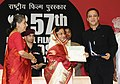 Pratibha Devisingh Patil presenting the Swarna Kamal Award to Shri Vidhu Vinod Chopra for Best Popular film Providing Wholesome Entertainment (Film 3 Idiots), at the 57th National Film Awards function, in New Delhi.jpg