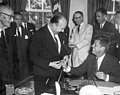 President John F. Kennedy Signs the Social Progress Trust Fund Agreement with the Inter-American Development Bank 01.jpg