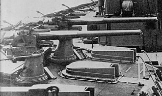 HMS Dreadnought (1906) - 12-pounder guns mounted on 'X' turret; note the sighting hoods on the turret roof.