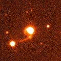 Quasar HE 1013-2136 with Tidal Tails.jpg