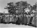 Queensland State Archives 6764 Women in costume in front of the sugar pioneers memorial Innisfail 4 October 1959.png