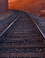 RR tracks running through a red rock canyon (8226264165).jpg