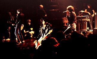 Subculture - Members of the seminal punk rock band Ramones wearing early punk fashion items such as Converse sneakers, black leather jackets and blue jeans.