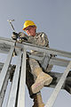 Removing a pin from a Maybey bridge in Camp Gazi, Afghanistan.jpg