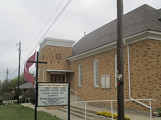 Rhome, Texas - Rhome United Methodist Church is located near the city hall downtown. It began in the 1880s with services held under brush arbors in a tent, with the first building completed in 1903.