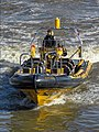 Rigid-hulled inflatable speedboat under Tower Bridge 02.jpg