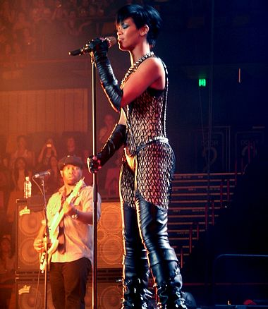 "Barbadian singer Rihanna had five songs on the chart. Her best-performing song was ""Take a Bow"" at number 12. Rihanna-brisbane-cropped2.jpg"