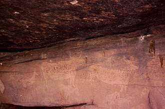 Cave painting - Prehistoric cave painting of animals at Albarracín, Teruel, Spain (rock art of the Iberian Mediterranean Basin)