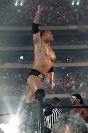 WrestleMania X8 - The Rock (left) poses to the crowd before his match against Hollywood Hogan (far right)
