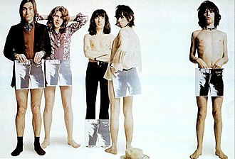 Sticky Fingers - The Rolling Stones posing in an ad with covers of Sticky Fingers, with the original artwork, in 1971, from left to right: Charlie Watts, Mick Taylor, Bill Wyman, Keith Richards, and Mick Jagger