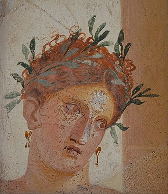 Olive - Roman fresco of a woman with red hair wearing a garland of olives, from Herculaneum, made sometime before the city's destruction in 79 AD by Mount Vesuvius (which also destroyed Pompeii).
