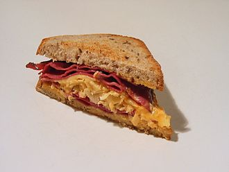 Cuisine of Omaha - One half of a Reuben sandwich