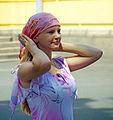 Russian woman putting headscarf.jpg