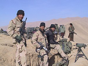 2002 State of the Union Address - U.S. Army Special Forces sergeant Mario Vigil in November 2001, with American and Northern Alliance forces west of Konduz, Afghanistan.