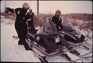 Snowmobile suit - Snowmobile drivers wearing snowmobile suits in Minnesota.