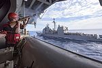 Sailor fires a shot line to USS San Jacinto from USS Dwight D. Eisenhower. (25669096133).jpg