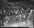 Salinas, California. Seated in family groups, evacuees of Japanese ancestry check in at Armory befo . . . - NARA - 536192.tif