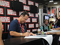 San Diego Comic-Con 2011 - Chief Creative Officer Joe Quesada signs for fans (Marvel booth) (5976788787).jpg