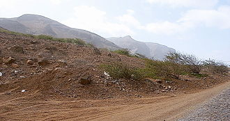 São Nicolau, Cape Verde - A cobblestone-paved road with the view of the island's mountain.