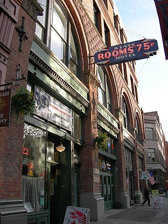 History of Seattle since 1940 - The State Hotel and Delmar Building, one of the many century-old buildings in Pioneer Square.