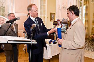 Șerban Nichifor - Belgian Ambassador Philippe Roland presenting Șerban Nichifor with the Order of the Crown in 2008